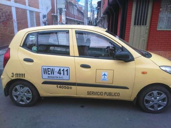 Taxi hyundai,modelo 2014,afiliado a taxis libres.